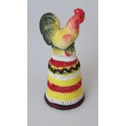 La poule jaune rouge et noire